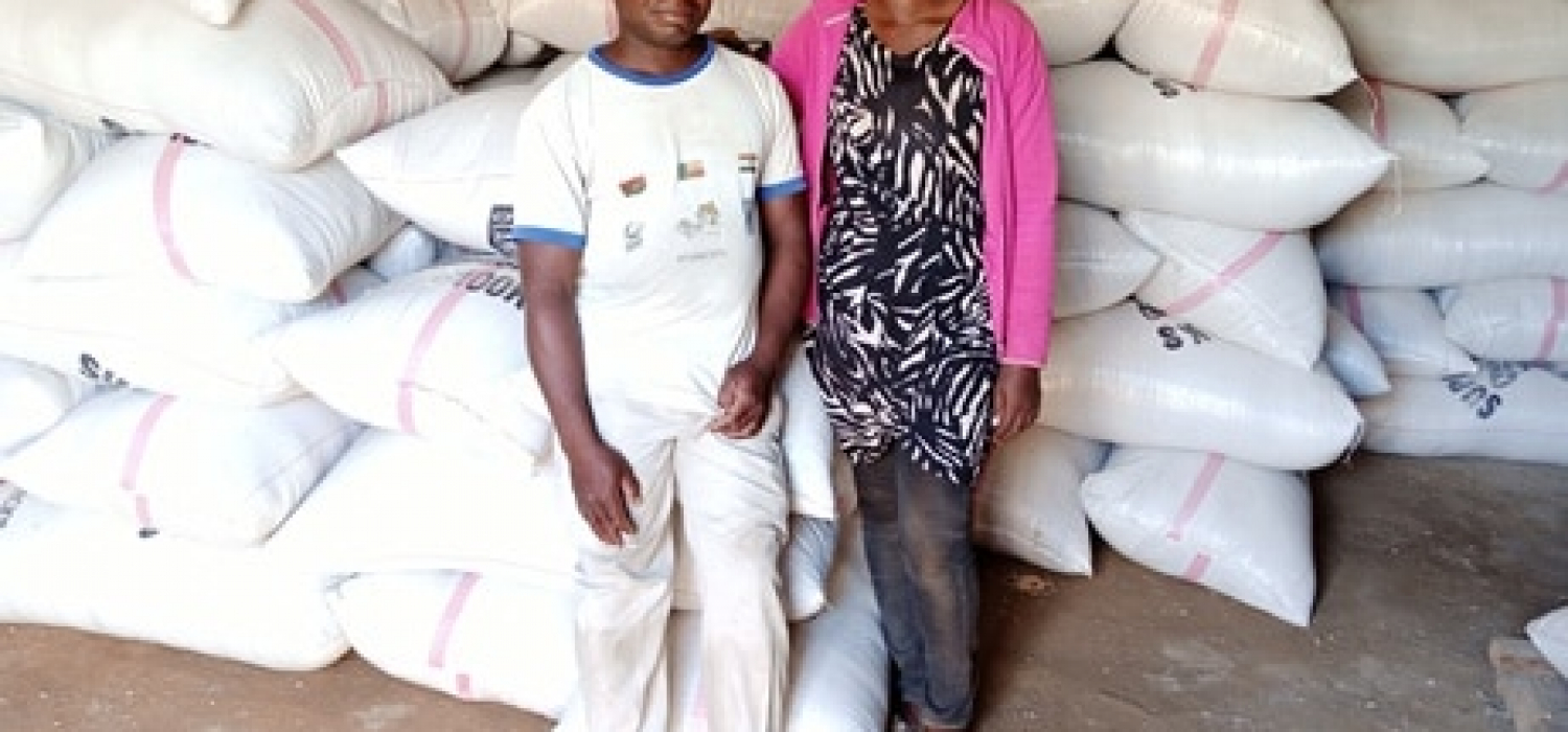 Abdoulaye yarou in front of his rice stock in the warehouse