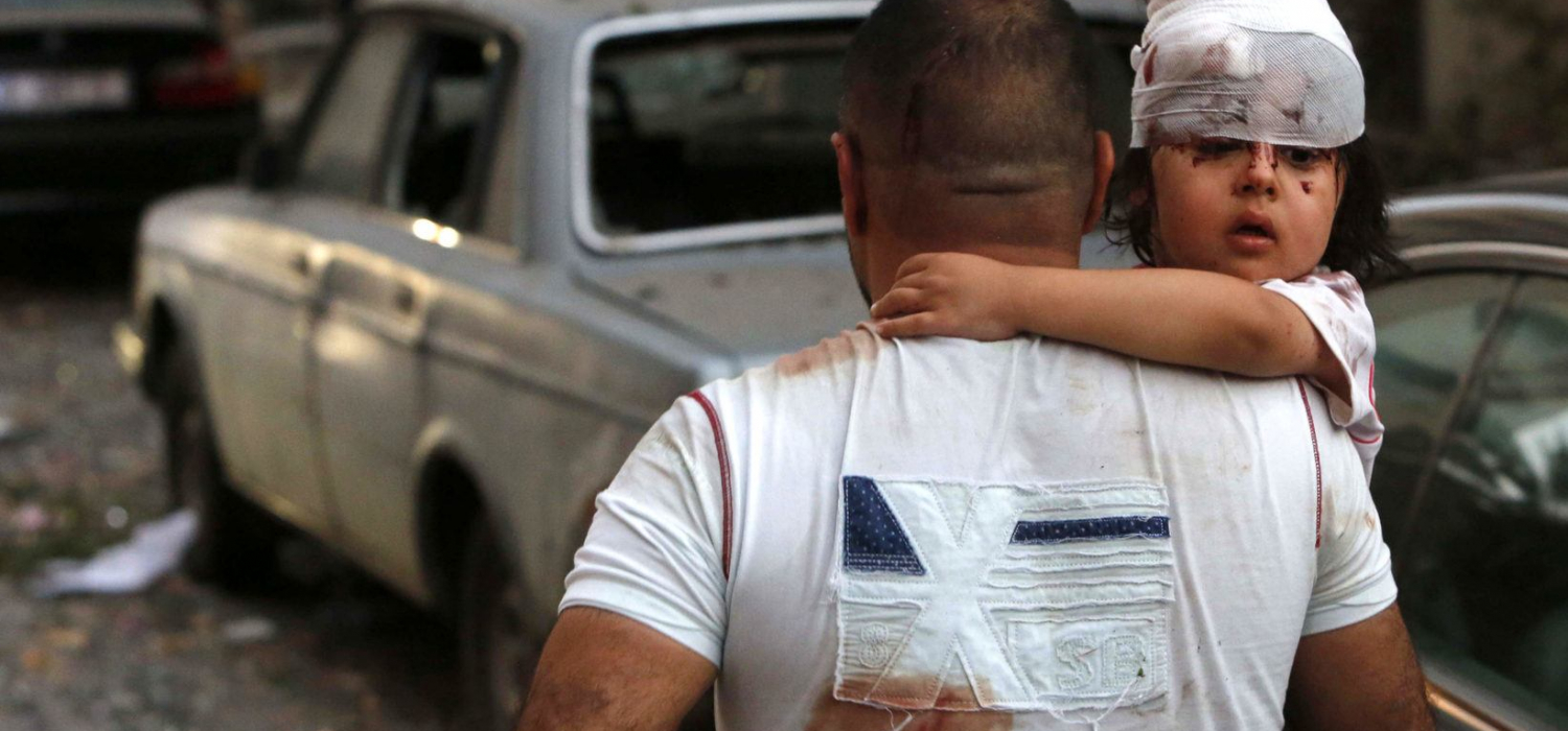 September 4, 2020, Beirut, Beirut, Lebanon: Lebanese carries away an injured on a street following an explosion in the Lebanese capital Beirut on August 4, 2020. Two huge explosion rocked the Lebanese capital Beirut, wounding dozens of people, shaking buildings and sending huge plumes of smoke billowing into the sky. Lebanese media carried images of people trapped under rubble, some bloodied, after the massive explosions, the cause of which was not immediately known (Credit Image: © Marwan Tahtah/APA Images via ZUMA Wire