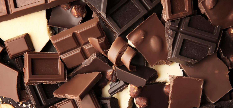 Heap of broken chocolate pieces, close up