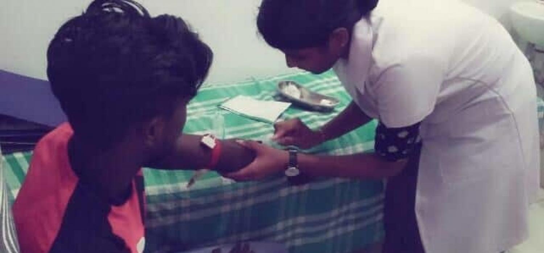 Thilaksha administering injection